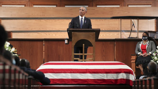Former President Barack Obama addresses the service during the funeral for the late Rep. John Lewis, D-Ga., at Ebenezer Baptist Church in Atlanta Thursday.