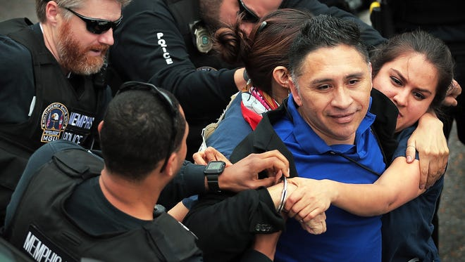 Memphis police arrestManuel Duran, the reporter for Spanish-language media during a Memphis protest this week. The original chargers behind the arrest have been dropped, but Duran remains in jail on an immigration hold, his defense lawyer said.