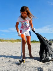 Keep Brevard Beautiful was out in force, cleaning up beaches and parks Tuesday morning, picking up trash and fireworks debris after the 4th of July weekend. Liza Lewis volunteered to pick up trash at Lori Wilson Park.