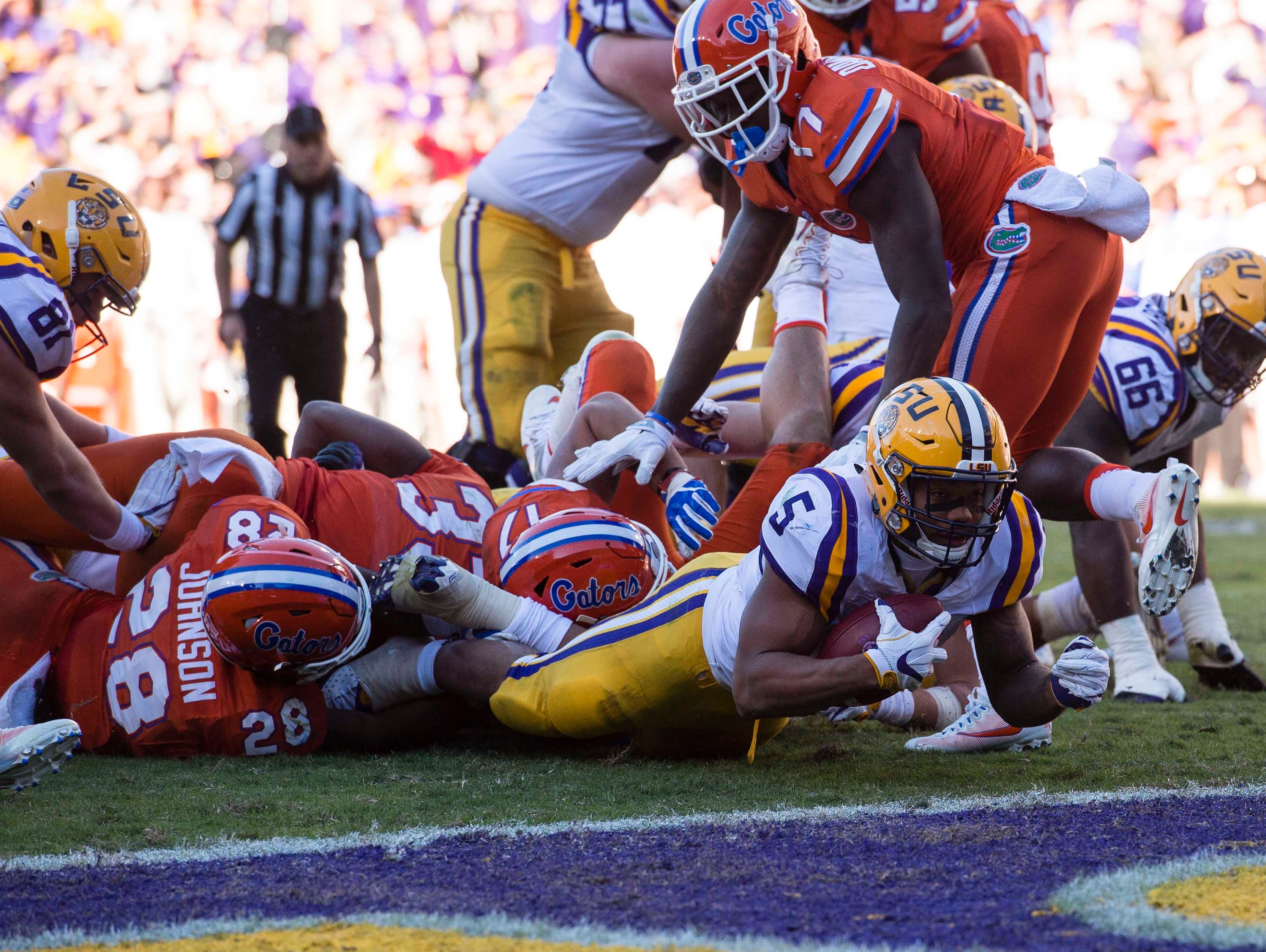 LSU Tigers running back Derrius Guice (5) is stopped short of the goal line on third down against the Florida Gators during the second half at Tiger Stadium. The Gators defeated the Tigers 16-10.