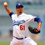 Josh Beckett pitches the second inning against the Chicago Cubs at Dodger Stadium.