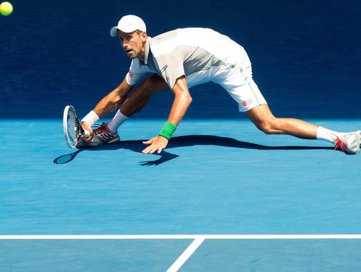 Novak Djokovic reaches down for a return against Leonardo Mayer.