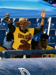 Pat Robertson cheers on the Rattlers Saturday during the Soul Bowl at Blue Wahoos Stadium.