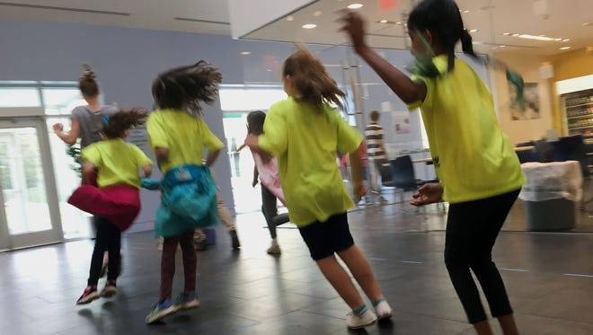 Students from Glen Acres Elementary School in Pennsylvania take part in a fun, hands-on Earth Day activity on Friday put together by Tatnall School seventh-graders and held at the Delaware Museum of Natural History in celebration of Earth Day.