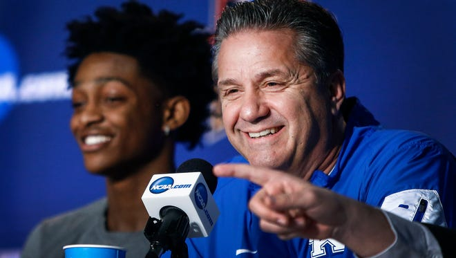 University of Kentucky freshman guard De'Aaron Fox (left) and head coach John Calipari (right) smile during a press conference as the team discusses their upcoming NCAA tournament Elite Eight game against the University of North Carolina Sunday evening at the FedExForum.