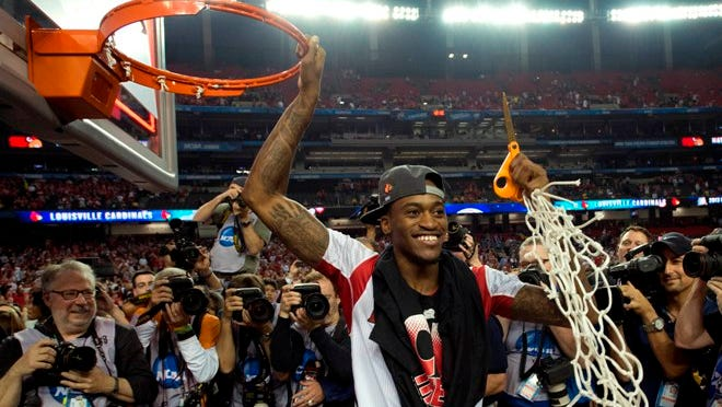Kevin Ware helps his teammates cut down the net after Louisville beat Michigan for the 2013 NCAA Championship.