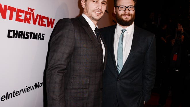"""FILE - In this Dec. 11, 2014 file photo, actors Seth Rogen, right, and James Franco attend the premiere of the Sony Pictures' film """"The Interview"""" in Los Angeles. Amid threats by hackers against movie theater's showing the film, Rogen and Franco pulled out of all media appearances promoting the film Tuesday, Dec. 16, 2014, canceling a Buzzfeed Q&A and Rogen's planned guest spot Thursday on """"Late Night With Seth Meyers."""" (Photo by Dan Steinberg/Invision/AP Images, File)"""