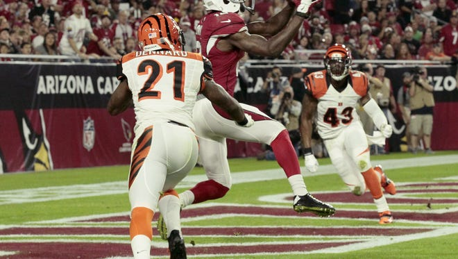Arizona Cardinals wide receiver John Brown (12) makes a touchdown catch in the third quarter of the NFL Week 11 game between the Arizona Cardinals and the Cincinnati Bengals at University of Phoenix Stadium in Glendale, Ariz., on Sunday, Nov. 22, 2015. The Bengals fell to 8-2 with the 34-31 loss to the Cardinals on a last second field goal.
