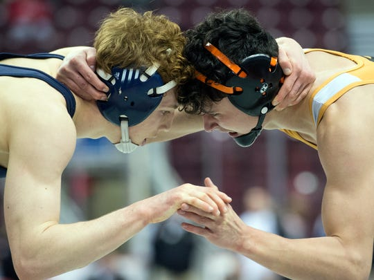 Central York's Mason Myers, right, wrestles Dallastown's Dalton Daugherty during a 132-pound bout, at the District 3 Class 3A wrestling tournament at the Giant Center in Hershey, Thursday, Feb. 22, 2018.