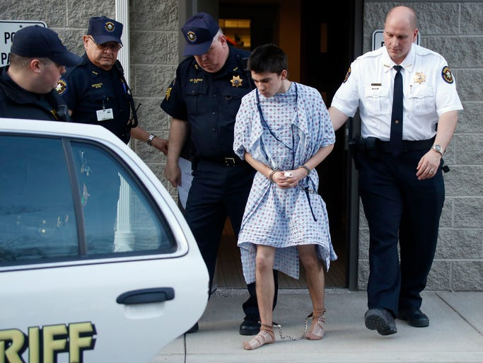 Alex Hribal, the suspect in the stabbings at the Franklin Regional High School in Murrysville, Pa., near Pittsburgh, is taken from a district magistrate after he was arraignedin Export, Pa.,on charges in theattack. Authorities say Hribal has been charged after allegedly stabbing and slashing at least 21 people, mostly students, in the crowded halls of his suburban Pittsburgh high school Wednesday.