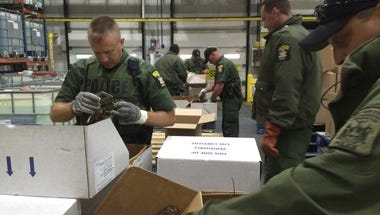 DEC officers inspect lobsters seized at the Price Chopper distribution facility in Schenectady.