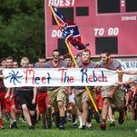 Members of the Hurley (Va.) High School Rebels run onto the football field on Aug. 14, 2015.