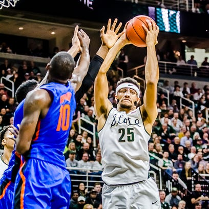 Kenny Goins ,25, of MSU grabs the rebound after he