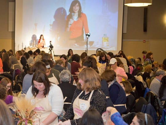 An event at the Jewish Community Center last November brought together 300 women to learn how to bake challah.