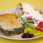The spinach platter, with spanakopita (spinach pie) and Greek salad, is a must-try at Pat's Place on Eau Gallie Boulevard beachside.