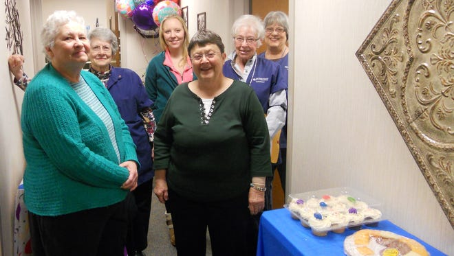 A group of volunteers enjoy goodies and each other's company during National Volunteer Appreciation Month activities in April at Ministry Saint Joseph's Hospital in Marshfield.