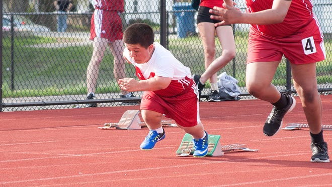 Michael Mendizabal, a sophomore at Coldwater High School, races in the 100-eter dash at Harper Creek High School on April 25.