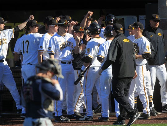 Iowa players get high-fives as three runs come in off