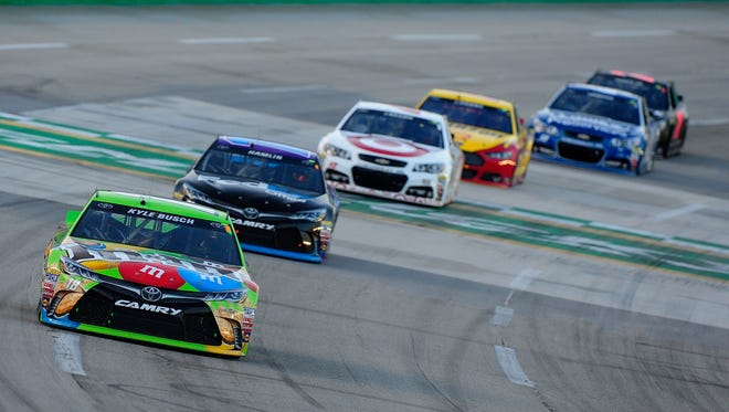 Jeff Curry/Getty Images Eventual winner Kyle Busch, in the No. 18 Toyota, leads a pack of cars during the race. ?Hell yeah, boys. Awesome job. Awesome job,? Busch said as he crossed the finish line. SPARTA, KY - JULY 11:  Kyle Busch, driver of the #18 M&M's Crispy Toyota, leads a pack of cars during the NASCAR Sprint Cup Series Quaker State 400 presented by Advance Auto Parts at Kentucky Speedway on July 11, 2015 in Sparta, Kentucky.  (Photo by Jeff Curry/Getty Images)
