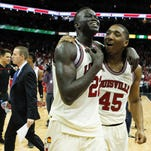 Louisville's Deng Adel and Donovan Mitchell embrace as they walk off the court after the Cards had a comeback win against Duke 71-64. Adel had 12 points and was the spark in the second half. Feb. 20, 2016