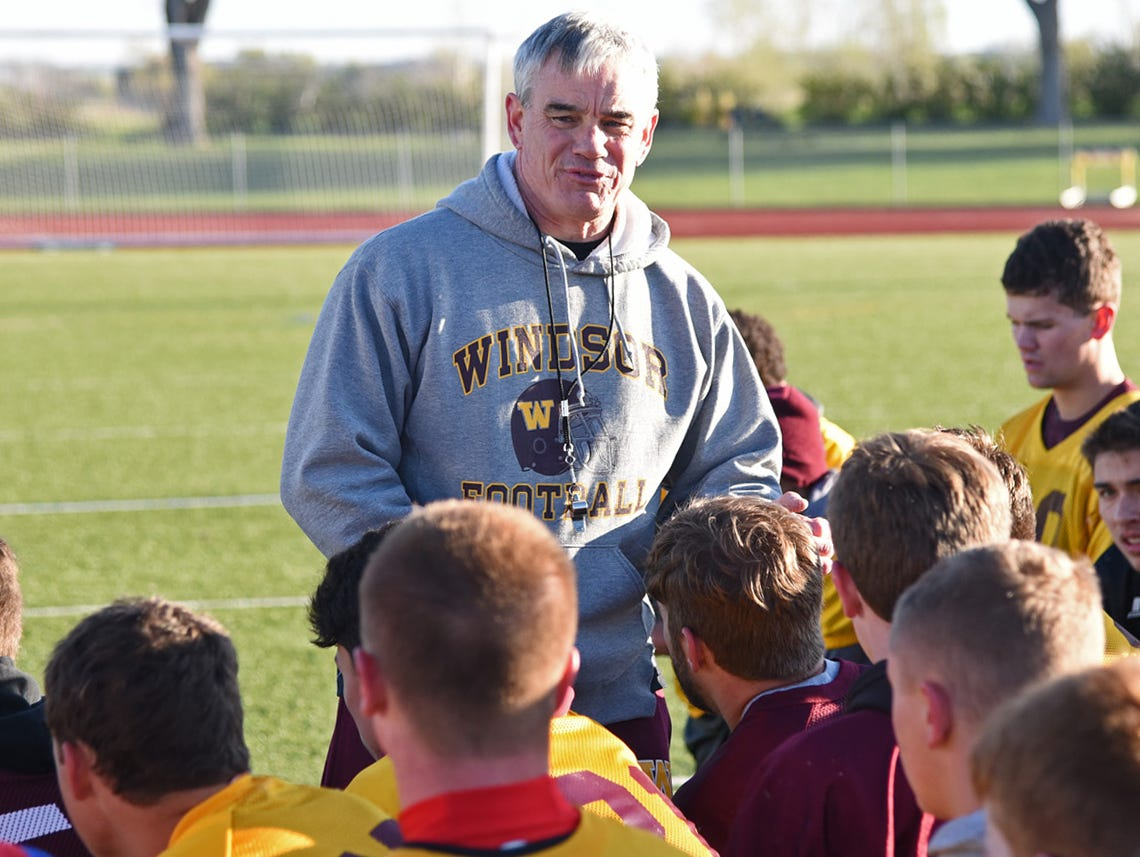 Windsor High School head football coach Chris Jones talks to his fotball team Wednesday following a morning spring practice.