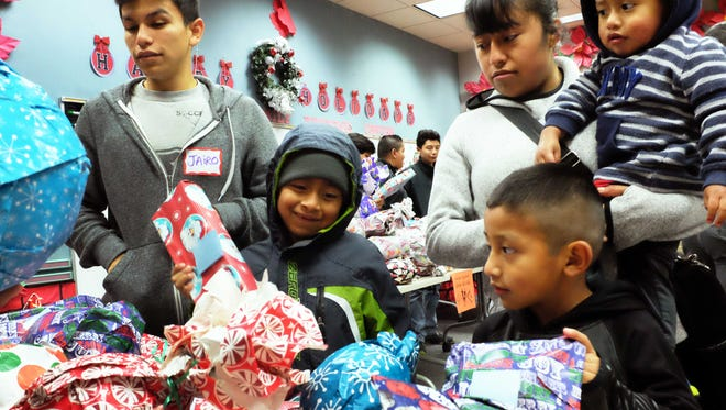 Families in need choose from many gifts available at the César Chávez Fútbol Academy's third annual toy drive on Friday.