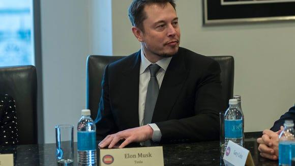 Tesla CEO Elon Musk attends a meeting of technology