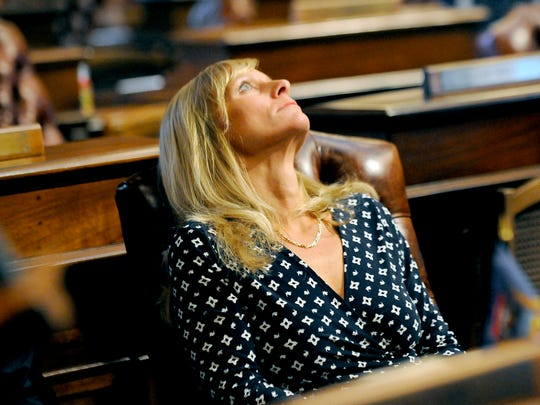 Michigan state Rep. Cindy Gamrat stares at the glass