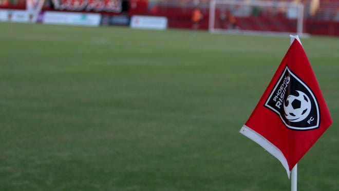 The corner flag blows in the wind before Phoenix Rising's match at Phoenix Rising Soccer Complex on Sept. 5, 2018.
