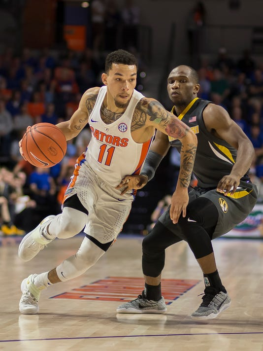Florida guard Chris Chiozza (11) dribbles past Missouri guard Terrence Phillips (1) during the second half of an NCAA college basketball game in Gainesville, Fla., Thursday, Feb. 2, 2017. Florida won 93-54. (AP Photo/Ron Irby)