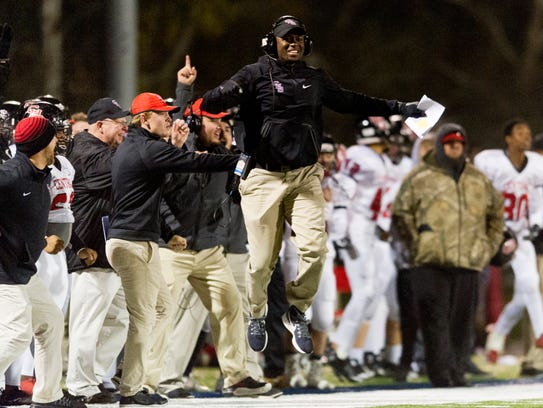 Central Head Coach Bryson Rosser celebrates after a