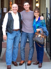 John Megale (center) with his parents, who he operated