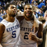 UK's Aaron Harrison, right, is elated as his twin brother Andrew Harrison, left, put in extensive work leading up to the NBA combine.