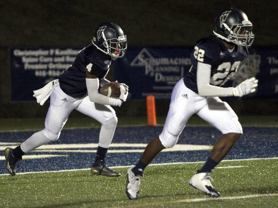 Pope John Paul II High junior Jamaal Thompson returns a kickoff as classmate Jalen Cambridge leads to block.