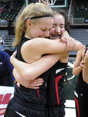Marshall Redhawks Natalie Tucker and Georgianna Pratley celebrate after winning the 2016 Class B State Finals.