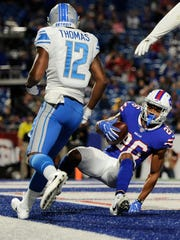 Buffalo Bills cornerback Greg Mabin (26) intercepts a pass to Detroit Lions' Dez Stewart (12) during the second half of a preseason NFL football game Thursday, Aug. 31, 2017, in Orchard Park, N.Y. (AP Photo/Adrian Kraus)