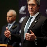 Philadelphia Eagles owner Jeffrey Lurie, left, listens as Doug Pederson, right, answers a question after he was introduced as the head coach of the Eagles NFL football team, Tuesday, Jan. 19, 2016, in Philadelphia. Pederson was the Kansas City Chiefs offensive coordinator the past three seasons. Pederson accepted the offer to become Philadelphia's coach last week. The team had to wait for the Chiefs to be eliminated from the playoffs before making it official. (AP Photo/Mel Evans)