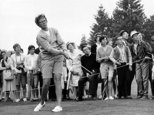 In this  1967 file photo, the gallery follows Mickey Wright's iron shot from the fairway at the Toronto Golf Club. Hall of Fame golfer Wright, who won 82 LPGA tournaments including 13 majors, died Monday, Feb. 17, 2020, of a heart attack, her attorney said. Wright was 85. (AP Photo, File)