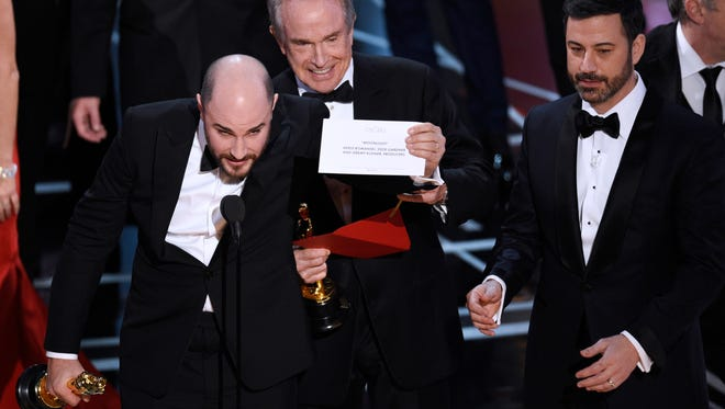 """Jordan Horowitz, producer of """"La La Land,"""" shows the envelope revealing """"Moonlight"""" as the true winner of best picture at the Oscars Sunday night. Accounting and consulting company PwC was responsible for the mistake, which might hurt its reputation."""