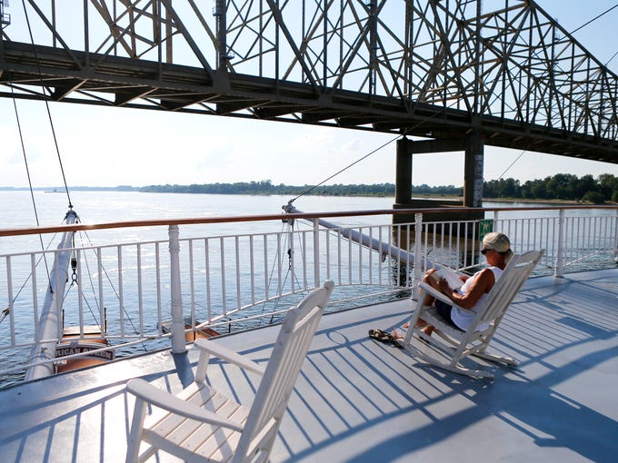 Cathy Fowler, from Blythe, Ga., reads on the sun deck