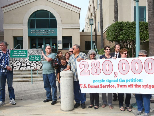 A group opposed to Nestle's extraction of water from the San Bernardino National Forest holds a rally before a court hearing at the U.S. District Court in Riverside on June 13, 2016.
