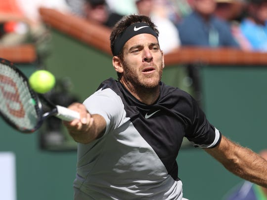 Juan Martin Del Potro hits a shot during his win over Roger Federer at the BNP Paribas Open, March 18, 2018.