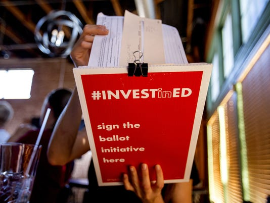 Teachers collect siguatures in support of 'Invest in Education Act'