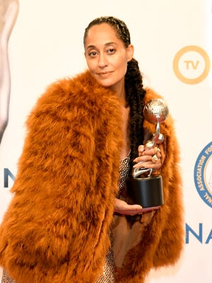 """""""It's an extraordinary thing to be able to show what a beautiful black family looks like on television,"""" said Tracee Ellis Ross said as she and the cast of 'Black-ish' accepted the comedy series honor at the NAACP Image Awards Monday."""