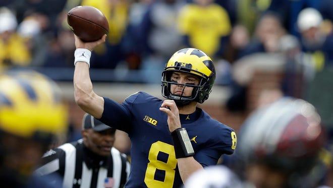 Michigan quarterback John O'Korn throws during the first half against Ohio State, Saturday, Nov. 25, 2017 in Ann Arbor.
