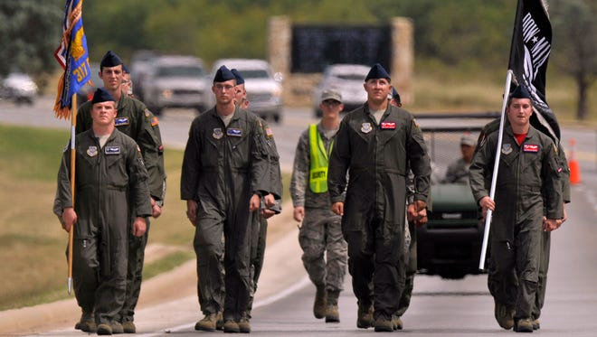 Members of the 317th Operations Group march in formation Friday Sept. 15, 2017. Dyess Air Force Base honored Prisoners of War and those Missing in Action on Friday which was National POW/MIA Recognition Day. In addition to special ceremonies marking the day, airmen continuously marched in formation along Arnold Boulevard carrying the POW/MIA flag from 7 a.m. to 5 p.m.