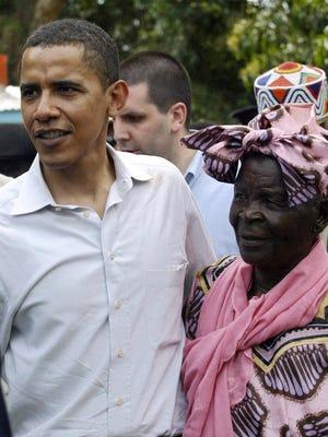Then-Sen. Barrack Obama greets his grandmother Sarah Obama at their rural home in Siaya, Kisumu, Kenya on  Aug. 26, 2006, during his first visit in 14 years.