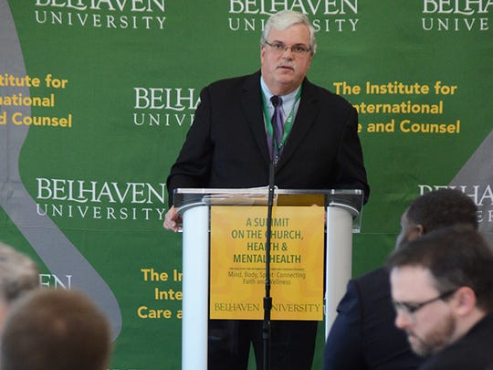 "Belhaven's Bradford Smith, author of ""Global Mental Health and the Church,"" speaks to counselors, pastors and health workers during the University's first mental health summit."