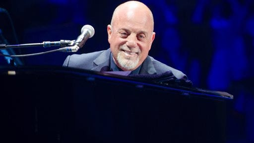 In this file photo, Billy Joel performs at Madison Square Garden in New York. The 2015 Bonnaroo Music and Arts Festival will feature a star-studded lineup including Joel, Mumford & Sons and Kendrick Lamar. Deadmau5, Robert Plant and Florence + the Machine will also perform during the four-day event kicking off June 11, 2015 in Manchester, Tenn.