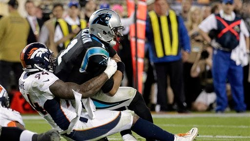 Denver Broncos' DeMarcus Ware (94) takes down Carolina Panthers' Cam Newton (1) during the second half of  Super Bowl 50.